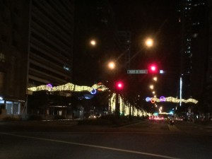 At the corner of Ayala Avenue and Paseo de Roxas waiting for the light to change.