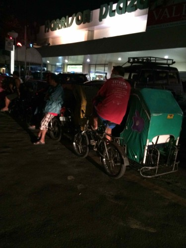 At the  Mabini Side of Harrison Plaza, some pedicabs are waiting for passengers