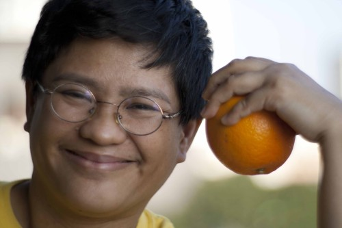 Reggie holding an orange