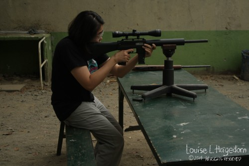 Ela's turn with the MAK 22. The rain stopped so we were able to shoot at the nearer table.